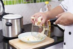 Chef prepared raw potato Stock Photography