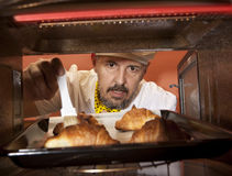 Chef prepares croissant in the oven Stock Photos