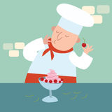 The chef prepares a dessert with berries Stock Photography