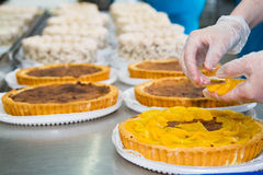 Chef prepares fruit cake Stock Photos
