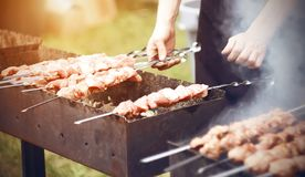 The chef prepares kebabs on the grill in the summer royalty free stock photo