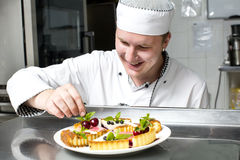 Chef prepares a meal Stock Images