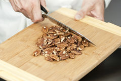 Chef Prepares Pecans. Close-up of a chef preparing pecans Stock Photography