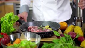 Chef prepares steak for cooking in kitchen stock video