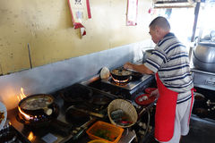 Chef prepares a stew of pork and herbal soup, ba kut teh in Tanj Royalty Free Stock Image