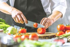 Free Chef Prepares Vegetables To Cook In The Restaurant Kitchen Royalty Free Stock Photo - 125098005