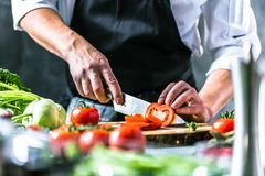 Free Chef Prepares Vegetables To Cook In The Restaurant Kitchen Royalty Free Stock Image - 125098196