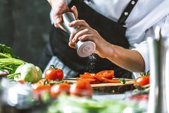 Free Chef Prepares Vegetables To Cook In The Restaurant Kitchen Stock Photos - 125098283