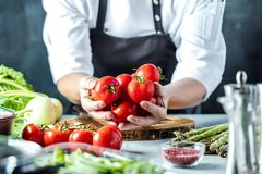 Free Chef Prepares Vegetables To Cook In The Restaurant Kitchen Stock Photography - 125098502