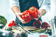 Free Chef Prepares Vegetables To Cook In The Restaurant Kitchen Royalty Free Stock Images - 125098859