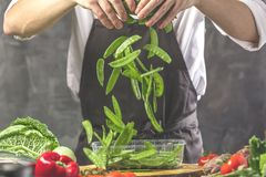 Free Chef Prepares Vegetables To Cook In The Restaurant Kitchen Royalty Free Stock Photo - 125098935