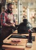 Chef preparing ceramic grill for a steak in a restaurant