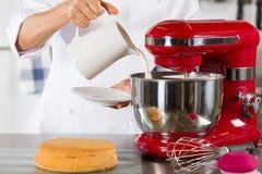 Chef preparing cream Stock Photography