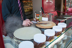 Chef preparing a crepe in front of the cafe in paris Royalty Free Stock Images