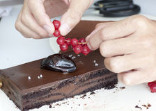 Chef preparing delicious chocolate cake Stock Images