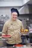 Chef preparing desert cake in the kitchen Stock Images