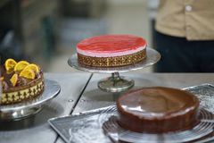 Chef preparing desert cake in the kitchen Stock Photos