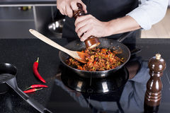 Chef preparing dishes in a frying pan Royalty Free Stock Photography