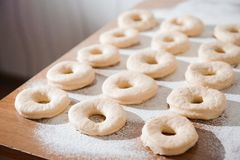 Chef preparing dough - cooking donuts process, work with flour. stock photos