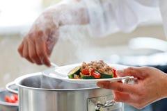 Chef preparing food Stock Photos