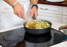 Chef preparing food Stock Images