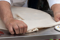 Chef is preparing food. Professional chef is preparing a dish using dough Stock Photography