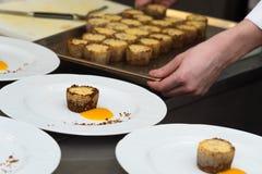Chef preparing food in restaurant kitchen Stock Image