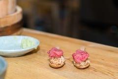 Chef preparing a fresh Tuna on a cutting board  for otoro sushi Royalty Free Stock Photography