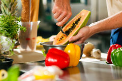 Chef preparing fruits Stock Photo