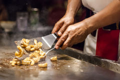 Chef preparing garlic shrimp Royalty Free Stock Photos