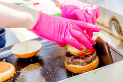 Chef preparing gourmet burger Royalty Free Stock Images