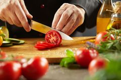 Chef preparing a healthy salad with fresh food royalty free stock images