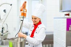 Chef preparing ice cream with food processor Stock Images