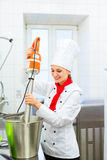 Chef preparing ice cream with food processor Stock Photography