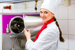 Chef preparing ice cream with machine Royalty Free Stock Image