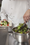 Chef Preparing Leaf Vegetables In Commercial Kitchen Stock Image