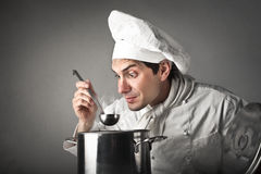 Chef preparing meal Royalty Free Stock Image