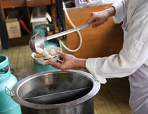A chef is preparing meat ball noodle Royalty Free Stock Images