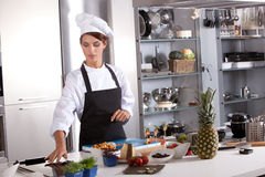 Chef preparing mise en place. Attractive female chef working in her kitchen preparing the meal Royalty Free Stock Photography