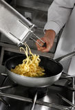 Chef preparing pasta Royalty Free Stock Image