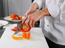 Chef preparing pepper Royalty Free Stock Image