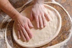 Chef Preparing pizza dough. In the restaurant Stock Photo