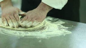 Chef preparing a pizza. stock video footage