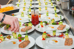 Chef preparing red tuna and salmon tartar. Chef cooking red tuna and salmon tartar with mesclun salad & citric foam Stock Photo
