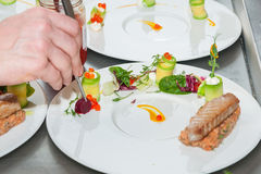 Chef preparing red tuna and salmon tartar. On restaurant Stock Photo