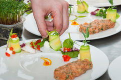 Chef preparing red tuna and salmon tartar. On restaurant royalty free stock images