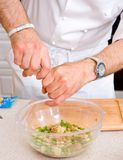 Chef preparing salad Royalty Free Stock Photography