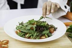 Chef preparing salad Royalty Free Stock Image
