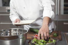 Chef Preparing Salad In Commercial Kitchen Stock Photo