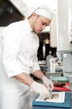 Chef preparing shrimps on board Stock Photos